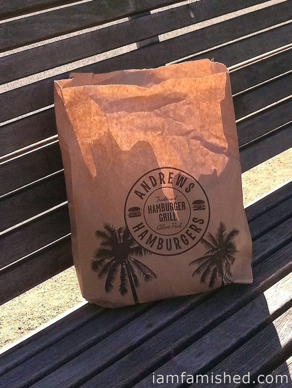 Brown bag on the bench across the road from Andrew's Hamburger