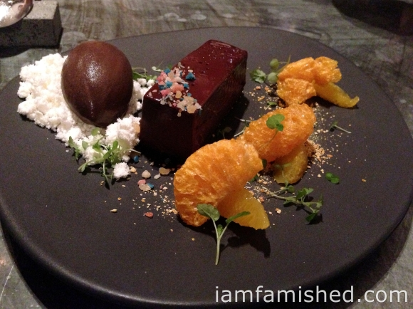 Em's chocolate tart, citrus textures, popping candy & choc cointreau sorbet