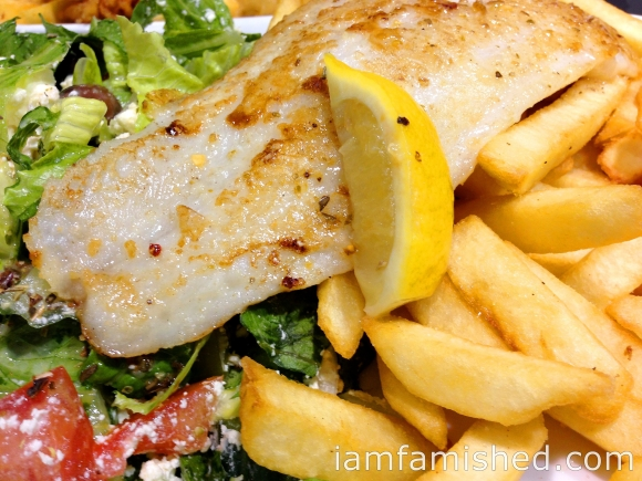 Grilled fish of the day, chips and salad