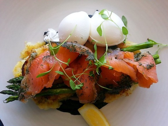 Poached Eggs on Potato & Leek Hash Cakes with Salmon Gravadlax, Chard Asparagus & Squid Ink Mayo