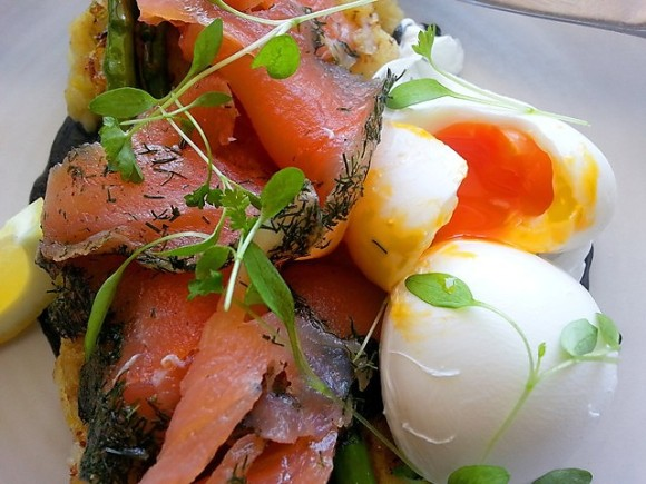 Poached Eggs on Potato & Leek Hash Cakes with Salmon Gravadlax, Chard Asparagus & Squid Ink Mayo (oozing egg)