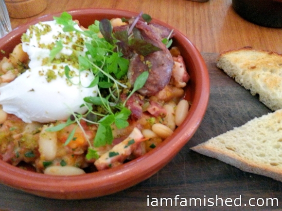 Breakfast Cassoulet (w/lstra smoked bacon + pork sausage herb crumb, poached eggs + sourdough)