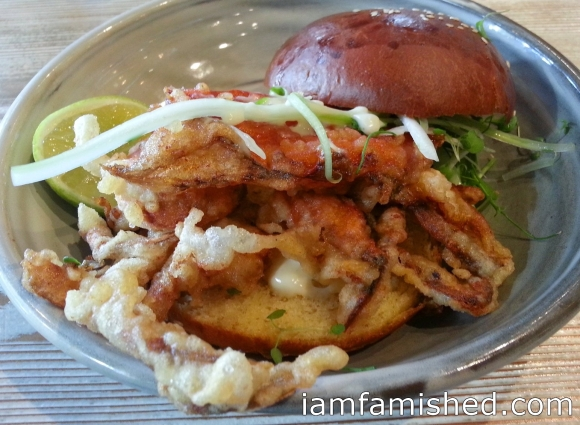 Fresh Qld. soft-shell mud crab roll with a fennel & dill salad & lime mayonnaise in a brioche bun