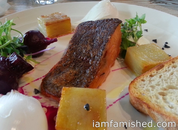 Gin and lime cured ocean trout fillet with pickled baby beetroots, potato galette, poached eggs, leaves, goats curd & toast
