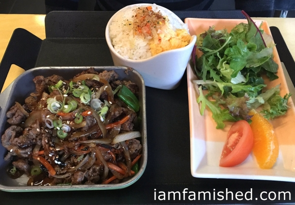 Beef Bulgogi (main size serving of stir fried thinly sliced beef in a sweet soy sauce served with warra warra style rice, salad and seasonal fruits)