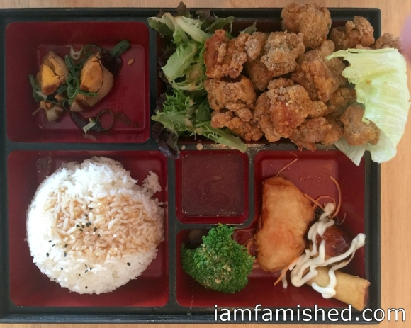 Popcorn Chicken Bento Box (boneless chicken pieces seasoned with sweet chilli powder on top, served with rice, seasonal sides in a oriental box)
