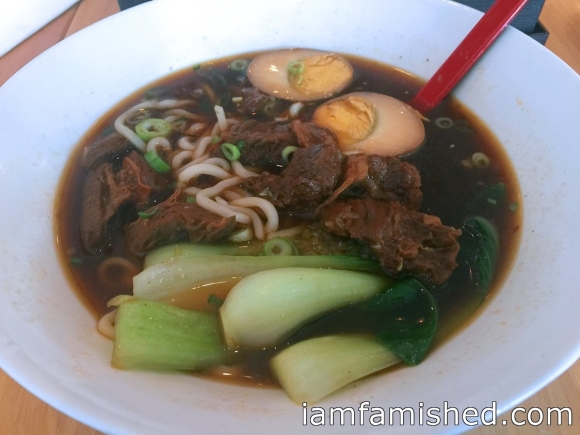 Taiwnese Beef Noodle Soup (beef brisket in Chef's special soup with vegetables, herb egg with thick noodle)