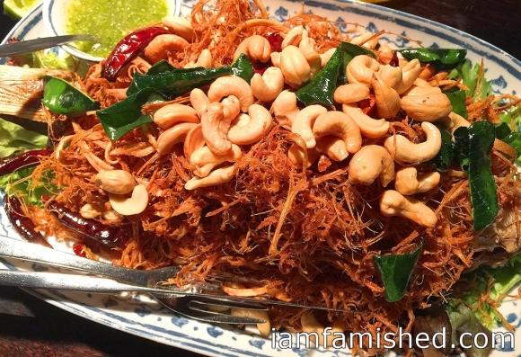 Bpla dtra khai (crisp whole snapper with fried and shredded lemongrass and wild ginger)