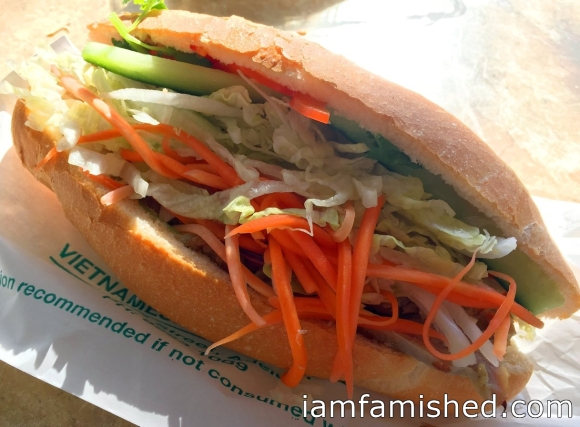Bánh mì (crispy bread roll with all fresh salad) - filling: roast pork