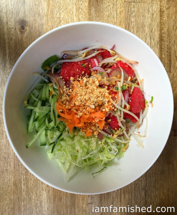 Vietnamese noodle salad bowl (a fresh combination of vermicelli rice noodles, crisp iceberg lettuce, pickled carrots, garlics, onions and fragrant mint leaves & dressed with garlic & chilli fish sauce) with BBQ pork meat balls