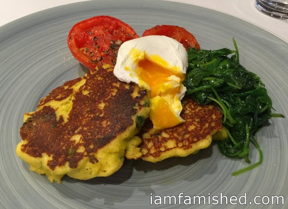 Polenta fritters (polenta, broccoli & sweet paprika fritter, poached egg, roasted tomatoes & sauteed baby spinach