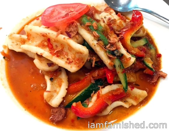 Sotong belado (squid simmered with delicately spiced hot chilli, onion, garlic, tomato and lemon juice)